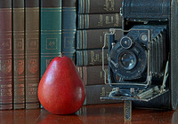 Still Life, Camera and Pear